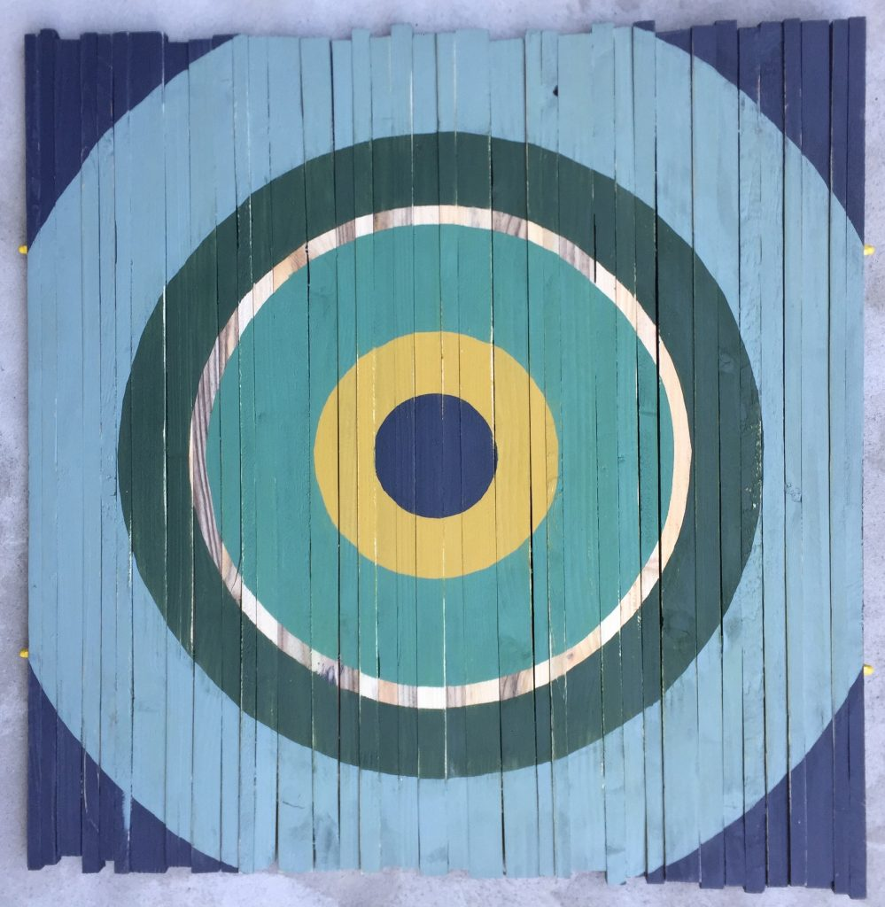 Target. Geometric art on recyled wood. Acrylic on wood. By Henriette Fabricius